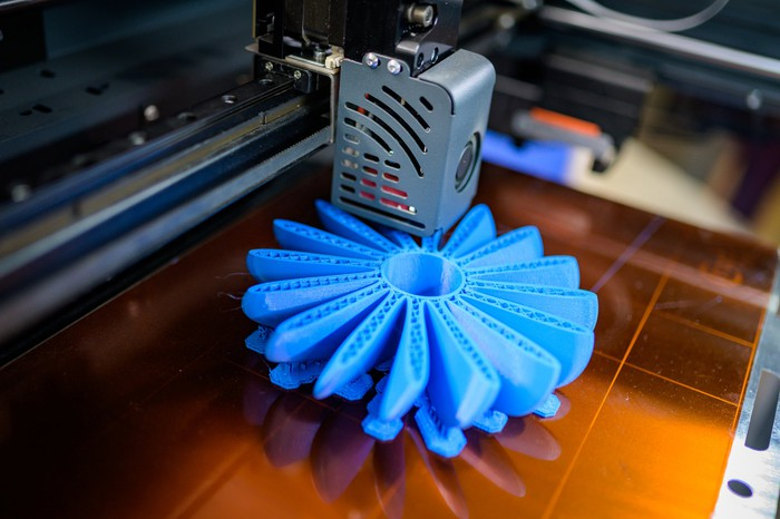 3D printed part being made.